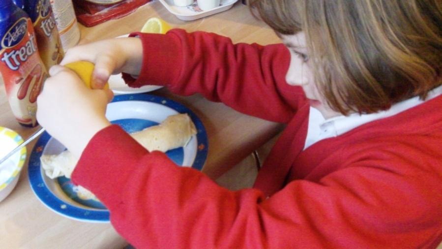 Rebekah adding lemon to her pancake
