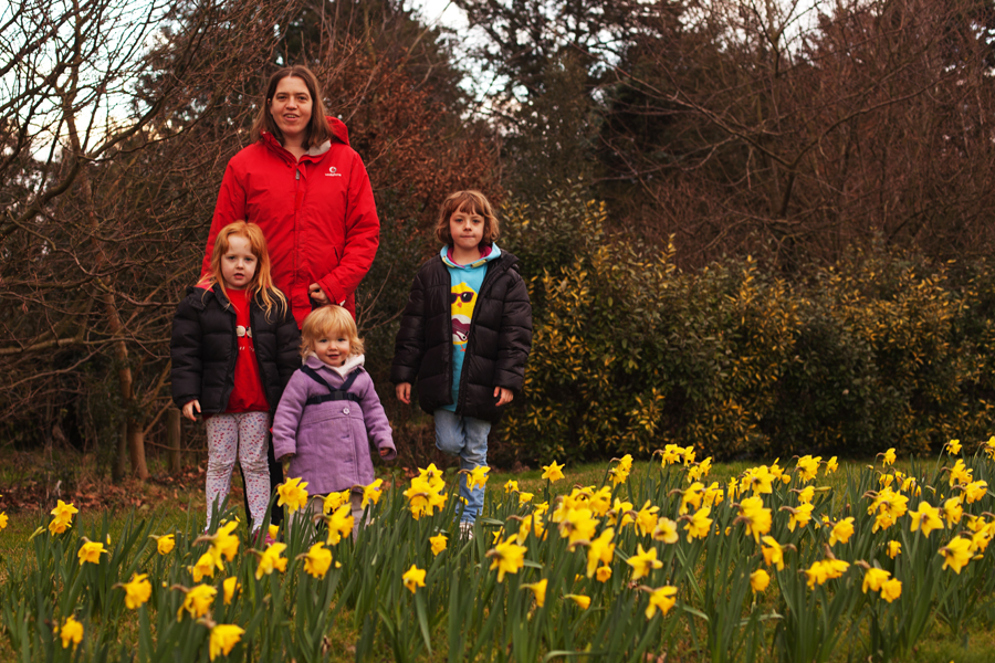 Four girls and a host of golden daffodils