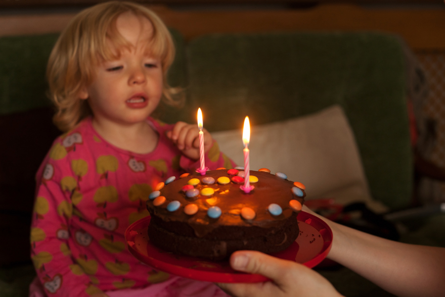 Emily hesitating in blowing out her candles - eventually Holly helped!