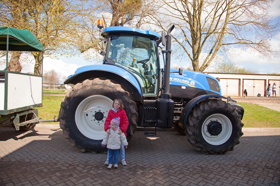 Rebekah and Emily beside the tractor