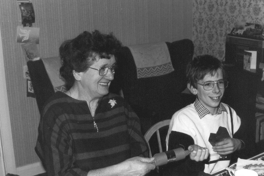 Pulling a cracker with Grandma
