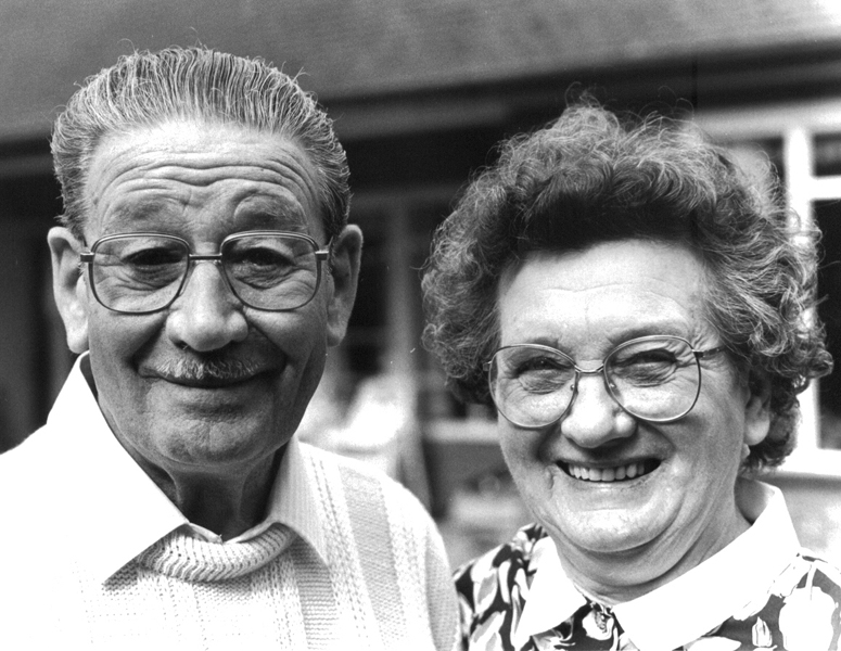 Grandad and Grandma in their garden celebrating 50 years of marriage