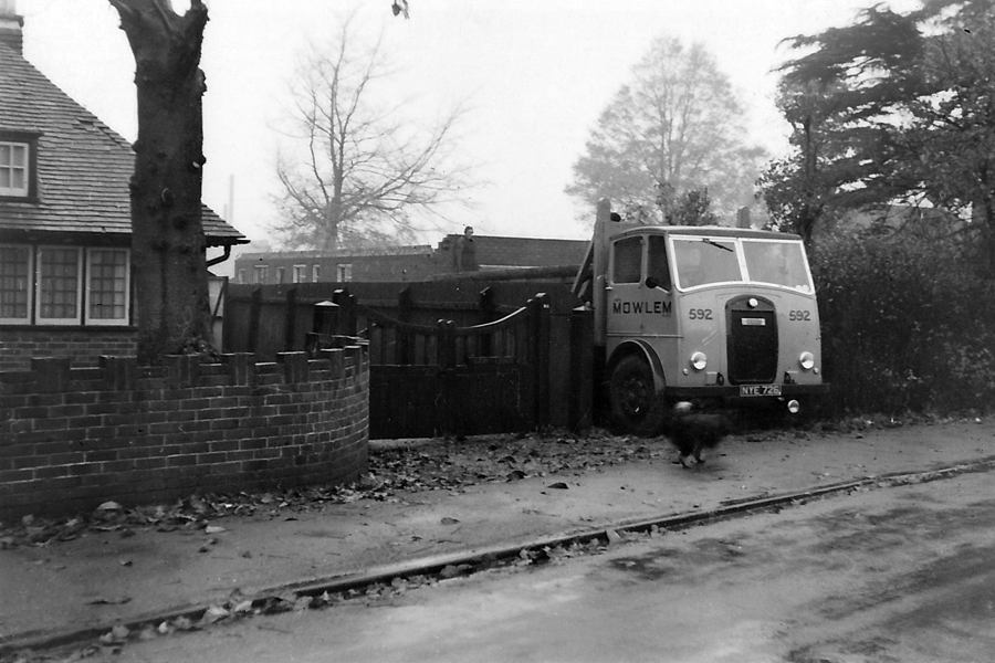A John Mowlem lorry, backed into the drive during construction of Number 55