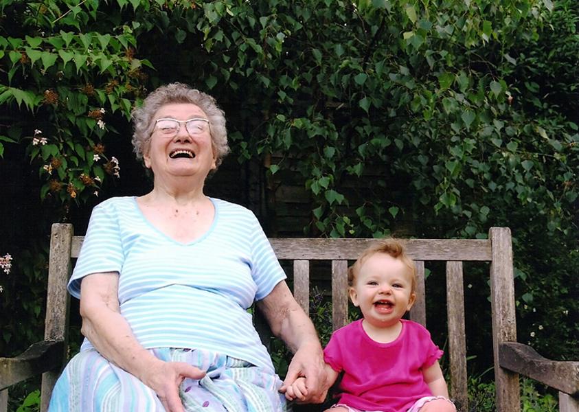 Grandma with Rebekah in the garden