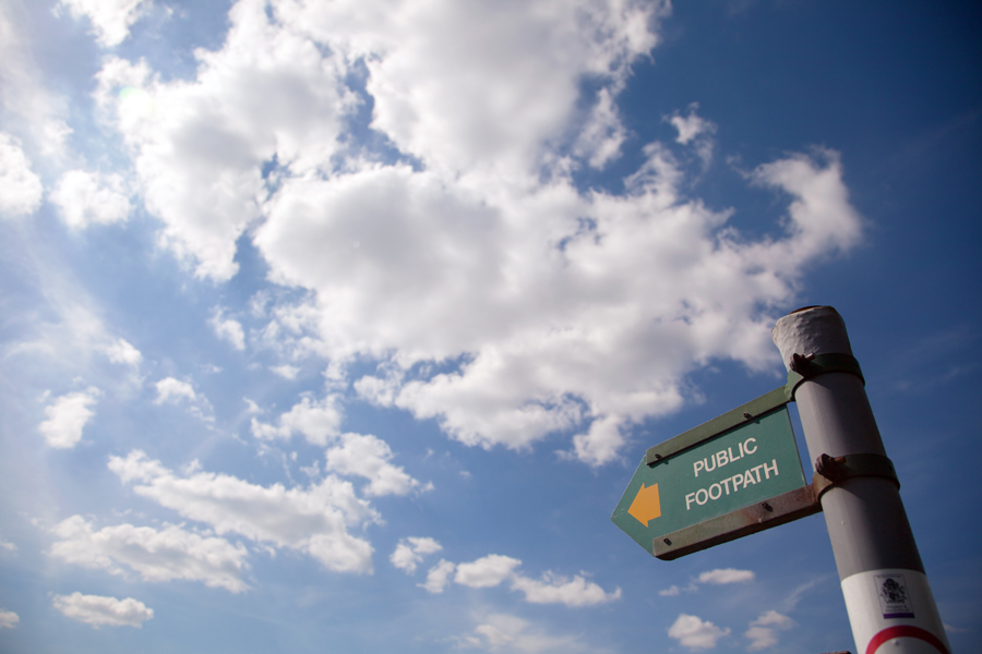 Footpath sign with a backdrop of blue sky