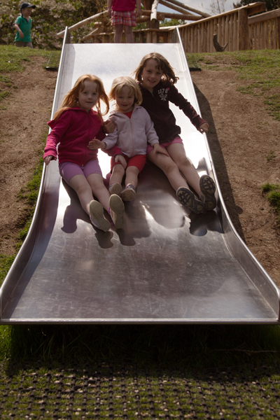 The girls on a new slide in the new play area
