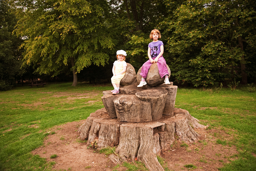 Sitting on the acorn sculpture