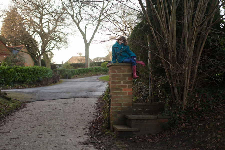 Rebekah on the gatepost